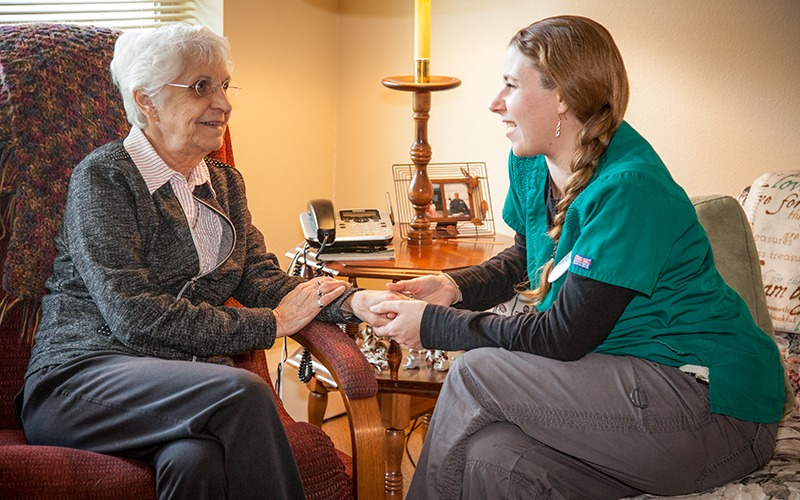 Majestic Pines Assisted Living staff member talking with a resident