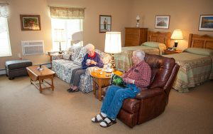 Two residents at Majestic Pines in their room